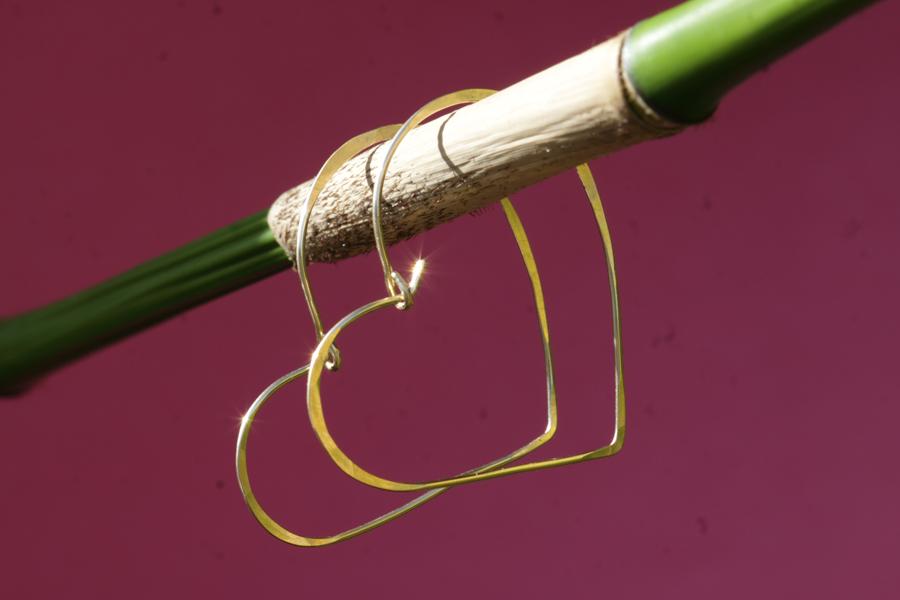 19. gold asymmetrical heart earrings